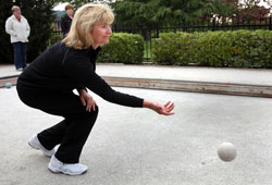 mature woman throwing bocce ball