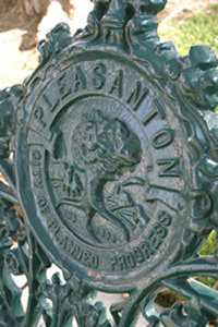 City seal stamped into round plaque on ornate metal gate